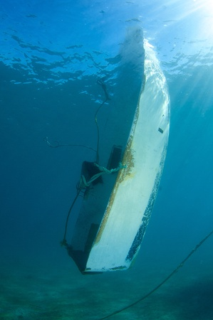 ship wreck: Swamped Dinghy Stock Photo