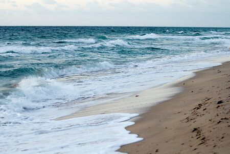 cloud drift: Wave action on a south Florida Beach early in the morning.