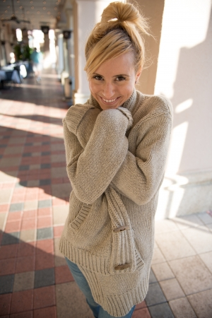 over sized: blonde hair model in an over sized sweater Stock Photo