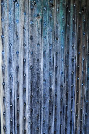 rivets: Old wooden door held together with iron rivets Stock Photo