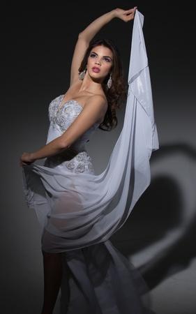 Model in a White Satin Gown, Studio