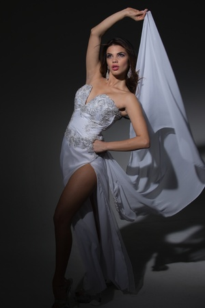 Model in a White Satin Gown, Studio