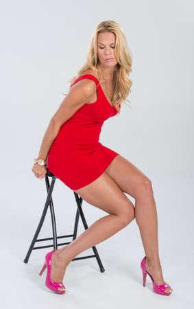 Pretty Blonde Model in a Red Dress