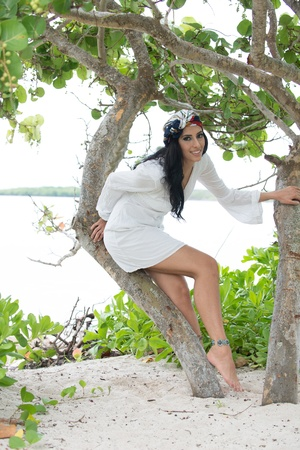 Model with black hair and white dress.
