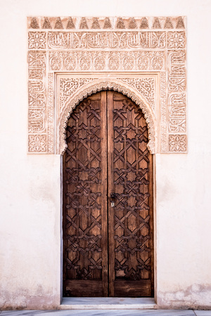 dacorated: wooden doors dacorated with islamic ornaments. Stock Photo