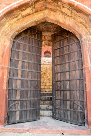 large doors: large old gate with wooden doors