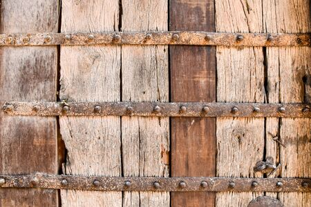 old metal: old wood texture with rusty metal craces and nails