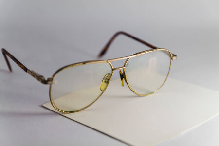 old brown glasses eye on a paper photo