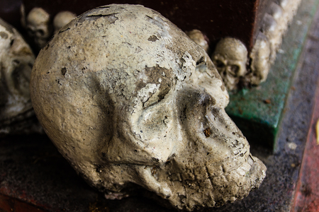 atrocity: human bone and skull in the temple  in Thailand .