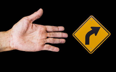 isolate Traffic signs on the road with hand  photo