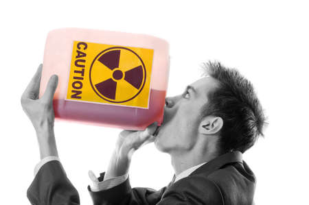 The man in a suit drinks poison gas