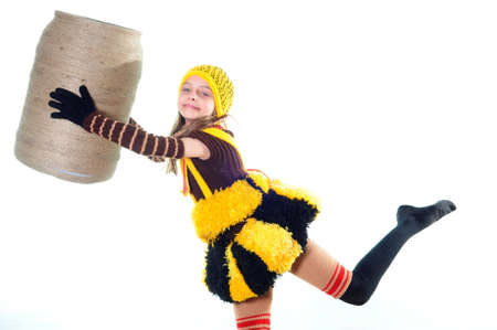 The joyful girl in a knitted suit holds to a flank Stock Photo