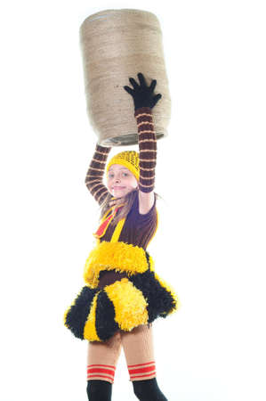 The girl in a suit of a bee holds over a head to a flank Stock Photo