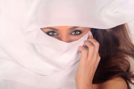 beautiful woman closes the face a white fabric  Stock Photo