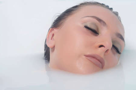 face of a beautiful woman in white water Stock Photo