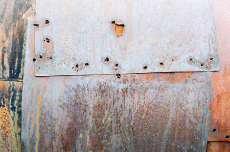 Rusty metal surface with holes photo