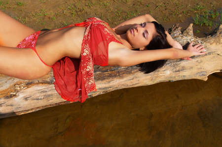 The attractive sexual young woman relaxes on a beach