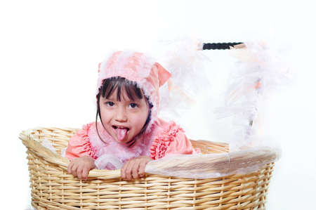 The little girl showing language on a white background