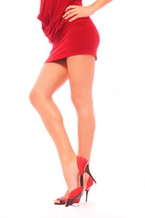 Feet of the sexual woman in a red dress Stock Photo - 5232942