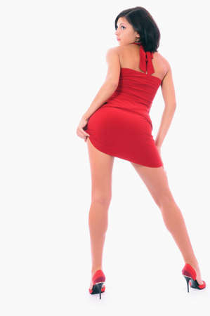 The beautiful girl in a short red dress. It is isolated on a white background Stock Photo - 5232582