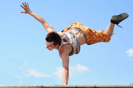 somersault: Young bboy doing somersault in air.
