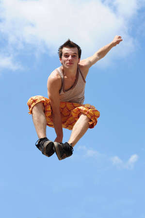 young guy does the big jump in air Stock Photo