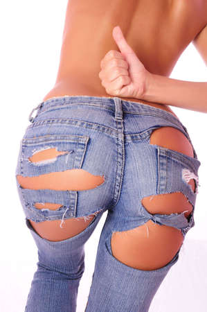 , harmonous woman in jeans, with a naked back Stock Photo