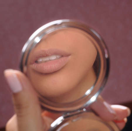 Lips of the girl are reflected in a mirror Stock Photo