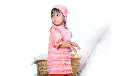 The nice little girl in a pink suit. A studio picture
