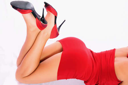 image of pretty lady in red dress over white Stock Photo