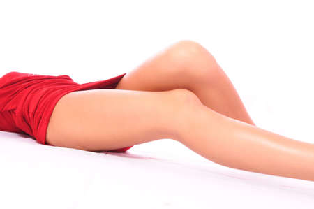 Beautiful long feet of the girl in a red dress Stock Photo