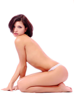 The woman naked sits on a white background Stock Photo