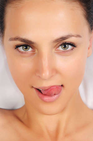 Portrait of the young woman who is putting out the tongue Stock Photo