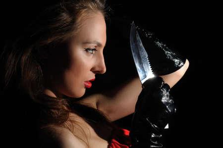brunette young girl holding big knife