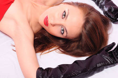 The young beautiful girl in black gloves