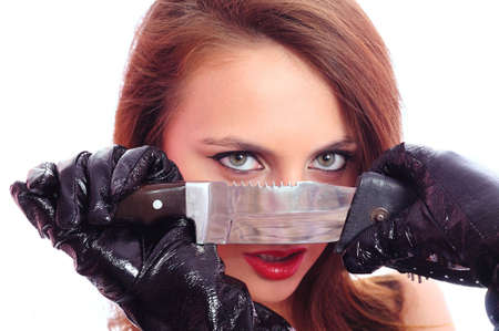 Portrait of the beautiful woman with a knife. Focus on an edge Stock Photo