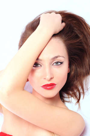 young brunette woman with red lips on a white backround Stock Photo