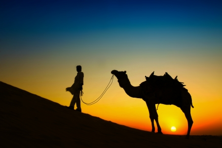 �Man and Camel�, Sam sand dune, Jaisalmer, India photo