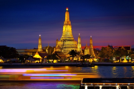 thailand s landmarks:  uFFFDWat Arun uFFFD, Temples of Thailand Wat Arun or  Temple of the Dawn  is a Buddhist temple in the Bangkok, Thailand, on the Thonburi west bank of the Chao Phraya River   Stock Photo