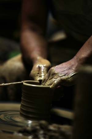 Making Ceramic Pottery  Wheels to create symmetric object such mug and jar with ease Stock Photo