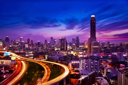 rise to the top: Traffic in modern city at night, Bangkok Thailand