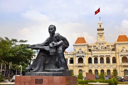 vietnam flag: Ho Chi Minh City Hall or Hotel de Ville de Saigon, Vietnam. Editorial