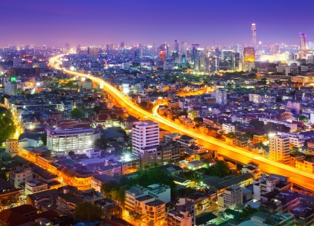Traffic in modern city at night, Bangkok Thailand photo