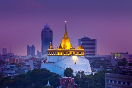 Night Urban City Skyline, Saket Temple  Golden mountain , Landmark of Bangkok, Thailand