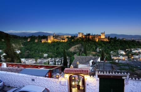The Alhambra in Granada from Albaicin at night with houses in the foreground. The Alhambra is a palace and fortress complex located in Granada, Andalusia, Spain