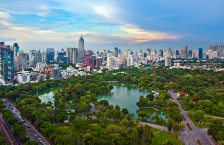 Modern city in a green environment, Suan Lum Lumpini Park is greenspace in Bangkok, Thailand photo