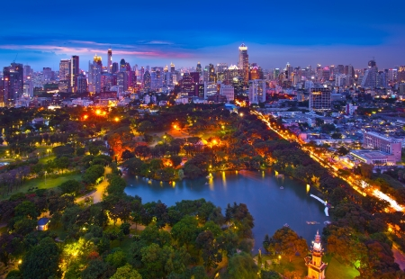 Night urban city skyline in a green environment, Suan Lum, Bangkok, Thailand  Suan Lum Lumpini Park is green space in Bangkok, Thailand  photo