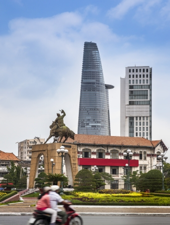 tran: Ho ji minh city, Vietnam  Statue of Tran Nguyen Hai and modern building  Ho Chi Minh City formerly named Saigon, is the largest city in Vietnam  Editorial