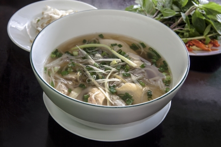 Pho Vietnamese Rice Noodle Soup  Pho is a Vietnamese noodle soup consisting of broth, rice noodles, a few herbs, and meat It is a popular street dish in Vietnam and around the world   photo