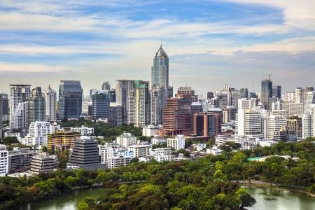 Modern city in a green environment, Suan Lum, Bangkok, Thailand  Suan Lum Lumpini Park is green space in Bangkok, Thailand  Stock Photo